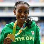 RIO DE JANEIRO, BRAZIL - AUGUST 12:  Almaz Ayana of Ethiopia poses with the gold medal for the Women's 10,000 Meters Final after setting a new world record of 29:17.45 on Day 7 of the Rio 2016 Olympic Games at the Olympic Stadium on August 12, 2016 in Rio de Janeiro, Brazil.  (Photo by Alexander Hassenstein/Getty Images)