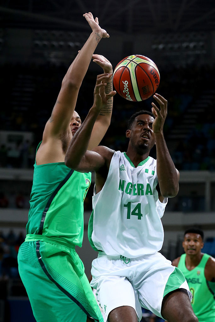 RIO DE JANEIRO, BRAZIL - AUGUST 15: Alade Aminu #14 of Nigeria drives past Rafael Hettsheimeir #30 of Brazil during a Men's Preliminary Pool B match on Day 10 of the Rio 2016 Olympic Games at Carioca Arena 1 on August 15, 2016 in Rio de Janeiro, Brazil. (Photo by Sean M. Haffey/Getty Images)
