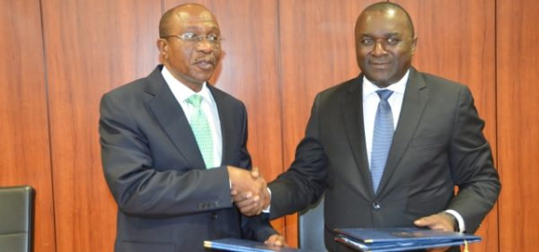 Incoming President, Godwin Emefiele (left), a outgoing President, Lucas A. Nchama (right).