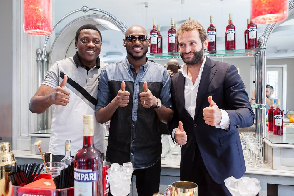 Head of Marketing, Brian Munro, Abayomi Ajao, Campari ambassador, 2Baba and Campari Materclass trainer, Tommaso Cessa at the home of Campari in Milan, Italy on Wednesday, August 3, 2016