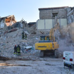 AMATRICE, ITALY - AUGUST 25:  Members of the emergency services work in the remains of buildings that collapsed after being struck by an earthquake, on August 25, 2016 in Amatrice, Italy. The death toll in the 6.2 magnitude earthquake that struck around the Umbria region of Italy in the early hours of  Wednesday morning has risen to at least 247 as thousands of rescuers continue to search for survivors.  (Photo by Carl Court/Getty Images)
