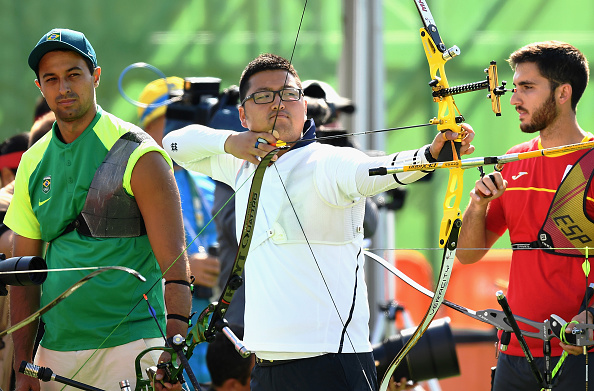 RIO DE JANEIRO, BRAZIL - AUGUST 05: Woojin Kim of Korea (C) competes during the Men's Individual Ranking Round on Day 0 of the Rio 2016 Olympic Games at the Sambodromo Olympic Archery venue on August 5, 2016 in Rio de Janeiro, Brazil. (Photo by Quinn Rooney/Getty Images)
