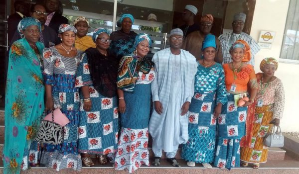 PIC. 1. THE NATIONAL PRESIDENT OF THE NATIONAL COUNCIL OF WOMEN'S SOCIETY (NCWS), CHEIF  MRS GLORIA SHODA AND THE OTHER EXECUTIVE MEMBERS OF THE COUNCIL IN AGROUP PHOTOGRAPH WITH THE INEC CHAIRMAN, PROF. MAHMOOD YAKUBU DURING A COURTESY VISIT TO HIS OFFICE IN ABUJA ON TUESDAY (23/8/16). 5934/24/8/2016/EO/BJO/NAN