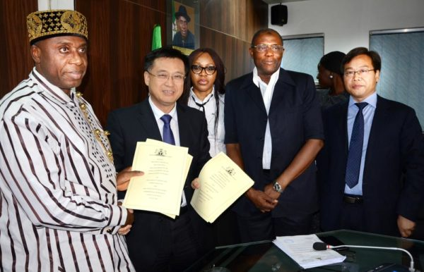 PIC.19. MINISTER OF TRANSPORTATION, CHIBUIKE AMAECHI (L) EXCHANGING A SIGNED AGREEMENT FOR THE COMPLETION OF WARRI-ALADJA- ITAPKE-AJAOKUTA-BARO-ABUJA (CENTRAL) RAILWAY LINE WITH THE VICE PRESIDENT, CHINESE RAILWAY CONSTRUCTION COMPANY (CRCC), CHEN XIAO XING (2ND-L), AT THE AGREEMENT SIGNING CEREMONY IN ABUJA ON FRIDAY (12/8/16). WITH THEM FROM RIGHT ARE: DIRECTOR OF CRCC, DOU YISUO; DIRECTOR OF RAIL TRANSPORT, FEDERAL MINISTRY OF TRANSPORTATION, MOHAMMED BABKOBI AND LEGAL OFFICER OF THE MINISTRY, IJEOMA UCHE.  THE AGREEMENT IS TO COMPLETE AND EXTEND THE CENTRAL RAILWAY LINE TO WARRI TOWN, PORT AND REFINERY; AND TO EXTEND IT NORTHWARD FROM EGANYI-JAKURA-BARO TO ABUJA. 5658/12/8/2016/BJO/NAN