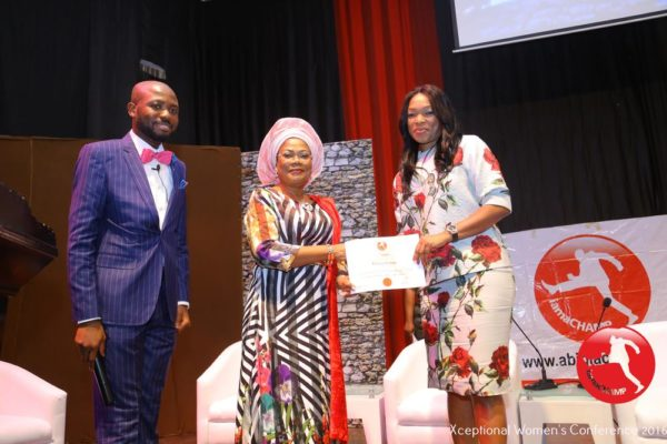 Patricia Obozuwa receiving The Xceptional Women's Role Model Award