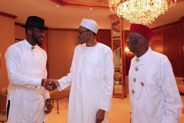President Buhari and Joseph Yobo