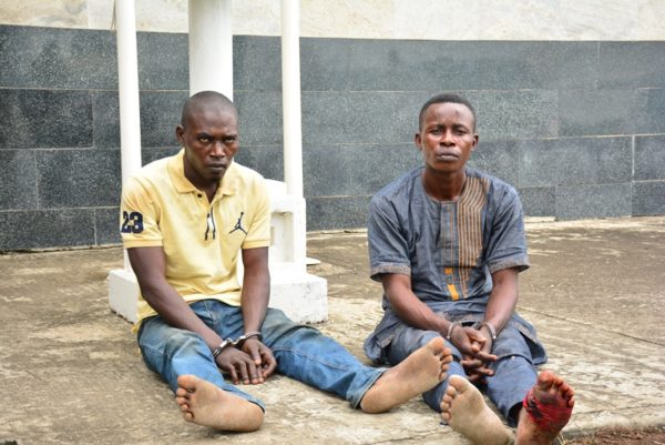 The suspected kidnappers of the Oniba of Iba, Toba Forejo (right) and Isaiah Ododomu (left) being paraded by the Police, at the Lagos House, Ikeja, on Sunday, August 7, 2016.