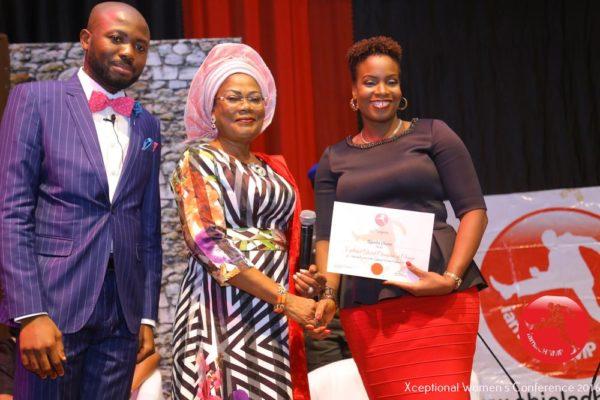 Ugochi Okere receiving The Xceptional Women's Role Model Award