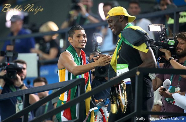 RIO DE JANEIRO, BRAZIL - AUGUST 14: Gold medalist for the men's 400m Wayde Van Niekerk of South Africa congratulates gold medalist of the men's 100m Usain Bolt of Jamaica on day 8 of the Rio 2016 Olympic Games at Olympic Stadium on August 14, 2016 in Rio de Janeiro, Brazil. (Photo by Jean Catuffe/Getty Images)
