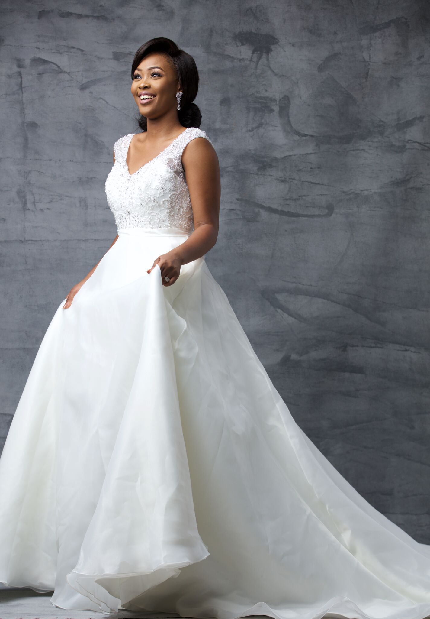 Estella: She is the bride who loves embellished simplicity. She loves clean lines and this is her subtle take on the classic ball gown silhouette.