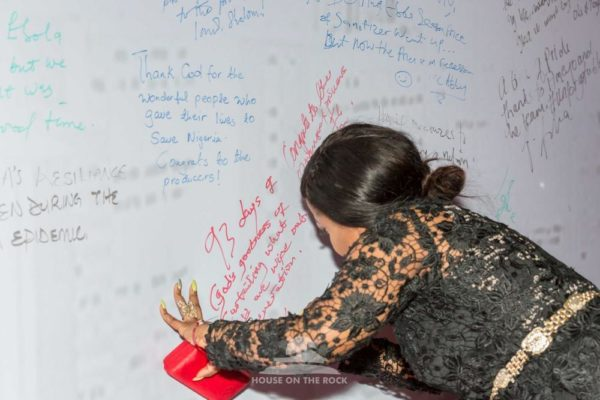 Kenny Saint Brown signing the wall