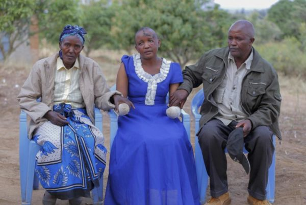 Jackline Mwende with her parents at their home in Machakos, Kenya