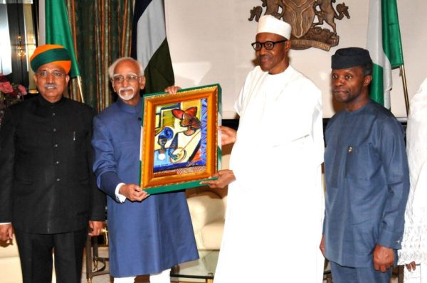 PIC.3. PRESIDENT MUHAMMADU BUHARI (2ND R), PRESENTING A SOUVENIR TO THE VISITING VICE PRESIDENT OF INDIA, MR MOHAMMAD HAMID ANSARI (2ND L), AT THE PRESIDENTIALVILLA IN ABUJA ON TUESDAY (27/9/16). WITH THEM ARE: VICE-PRESIDENT YEMI OSINBAJO (R) AND INDIAN MINISTER OF STATE FOR FINANCE, MR GANGARAM MEGHWAL.  7136/27/9/2016/ CALLISTUS EWELIKE/DKO/BJO/NAN