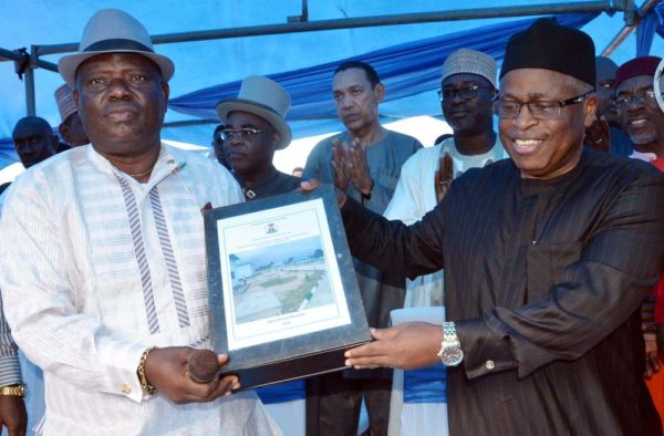 PIC.40. COMMISSIONER OF WATER RESOURCES IN BAYELSA, MR NENGI TUBENAH (L) RECEIVING THE HANDOVER NOTE OF THE CENTRAL OGBIA REGIONAL WATER SUPPLY PROJECT FROM THE DIRECTOR OF WATER SUPPLY, FEDERAL MINISTRY OF WATER RESOURCES, MR BENSON AJISEGIRI, DURING THE INAGURATION OF THE PROJECT IN OTUOKE, BAYELSA, ON THURSDAY (8/9/16). ABOUT 130,000 PEOPLE FROM 13 COMMUNITIES ARE EXPECTED TO BENEFIT FROM THE N5.9BILLION WATER PROJECT. 8/9/2016/JAU/BJO/NAN