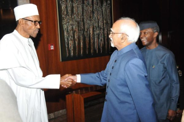 PIC.5. PRESIDENT MUHAMMDU BUHARI WELCOMING THE VISITING VICE PRESIDENT OF INDIA, MR MOHAMMAD HAMID ANSARI TO THE PRESIDENTIAL VILLA IN ABUJA ON TUESDAY (27/9/16). RIGHT IS VICE PRESIDENT YEMI OSINBAJO. 7137/27/9/2016/CALLISTUS EWELIKE/DKO/BJO/NAN
