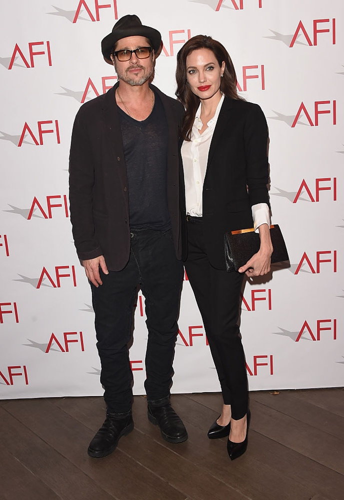 BEVERLY HILLS, CA - JANUARY 09: Actor/producer Brad Pitt (L) actress/director Angelina Jolie attend the 15th Annual AFI Awards at Four Seasons Hotel Los Angeles at Beverly Hills on January 9, 2015 in Beverly Hills, California. (Photo by Jason Merritt/Getty Images)