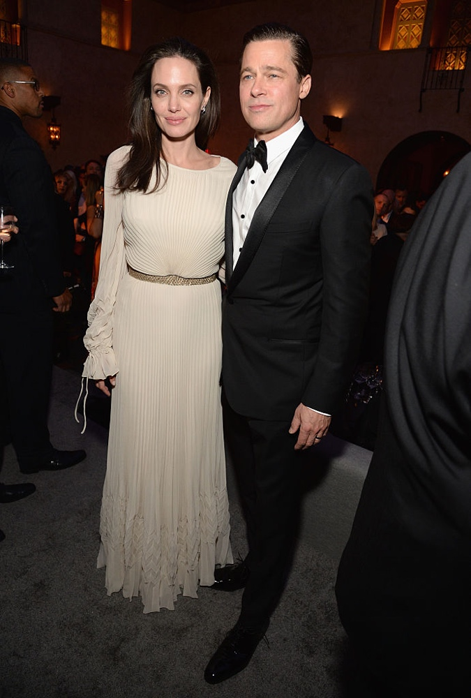 "HOLLYWOOD, CA - NOVEMBER 05: Writer-director-producer-actress Angelina Jolie Pitt (L) and actor-producer Brad Pitt attend the after party for the opening night gala premiere of Universal Pictures' ""By the Sea"" during AFI FEST 2015 presented by Audi at TCL Chinese 6 Theatres on November 5, 2015 in Hollywood, California. (Photo by Michael Kovac/Getty Images for AFI)"
