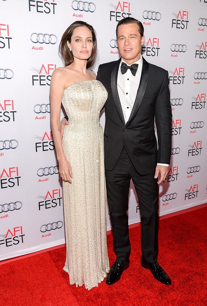 LOS ANGELES, CA - NOVEMBER 05: Writer-director-producer-actress Angelina Jolie Pitt (L) and actor-producer Brad Pitt attend the opening night gala premiere of Universal Pictures' 'By the Sea' during AFI FEST 2015 presented by Audi at TCL Chinese 6 Theatres on November 5, 2015 in Hollywood, California. (Photo by Michael Kovac/Getty Images for AFI)