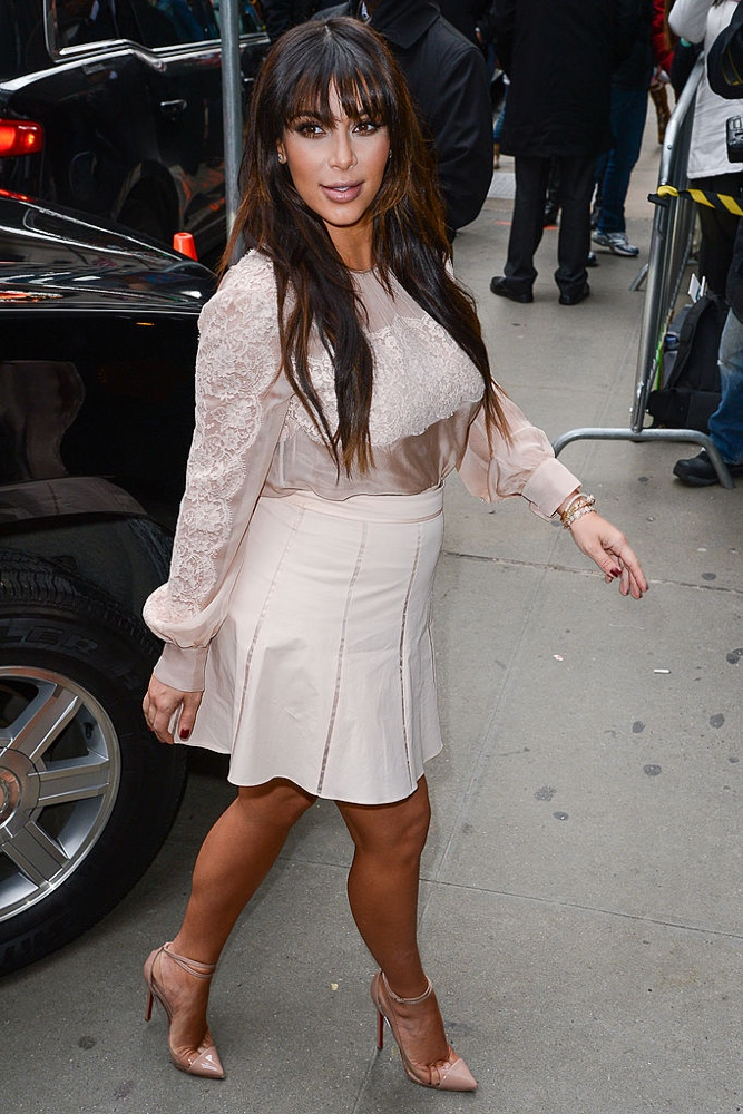 "NEW YORK, NY - MARCH 26: TV personality Kim Kardashian enters the ""Good Morning America"" taping at the ABC Times Square Studios on March 26, 2013 in New York City. (Photo by Ray Tamarra/Getty Images)"