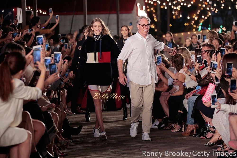 NEW YORK, NY - SEPTEMBER 09: Model Gigi Hadid (L) and designer Tommy Hilfiger walk the runway at #TOMMYNOW Women's Fashion Show during New York Fashion Week at Pier 16 on September 9, 2016 in New York City. (Photo by Randy Brooke/Getty Images for Tommy Hilfiger)