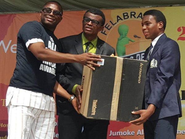 Country Director Nigeria, AFRIMA, Mr. Kingsley James Presenting a Desktop Computers to the Winner, 2016 Felabration School Debate, Emaka Omo-Lamai (L) and Mr. Kono-Ugen Kono (Middle) of Dowen College During the Presentation of Prize to the Winner