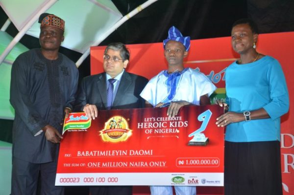l-r: director of marketing, daar communications plc, mr lanre awoyemi; group managing director, dufil prima foods plc, mr deepak singhal; winner, intellectual bravery category, 2016 indomie independence day awards for heroes of nigeria (iida), master babatimileyin daomi, and managing director, stanbic holdings plc, mrs shola david-borha, at the 2016 iida held in lagos