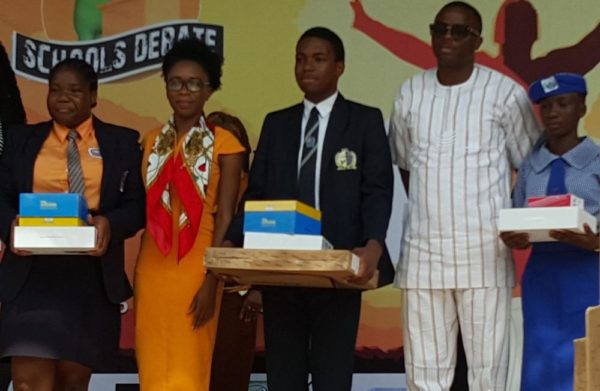 The 2nd Runner-up, 2016 Felabration School Debate, Eze Okoli; Judge, Ms Princess Abumere, Judge Winner of Felabration 2016 Secondary School Debate Emake Omo- Lamai and Country Director, Nigeria, AFRIMA, Mr. Kimgsley James and the third position
