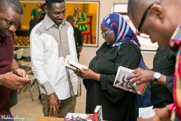 A cross section of guests checking out the book in Abuja