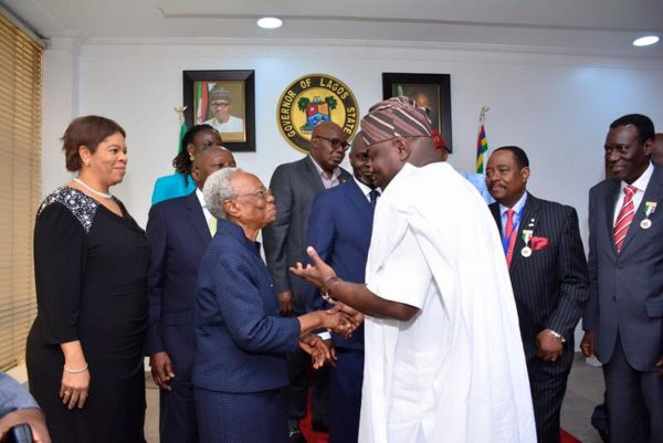 Ambode shaking hands with Margaret Rose Adetutu Adeleke during a courtesy visit to the Governor