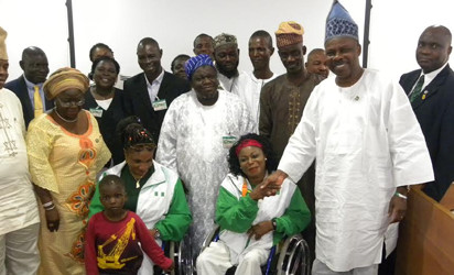 Governor Amosun in Handshake with Latifat Tijani after presenting the donation