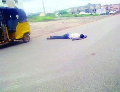 Chidozie Anyanwu Lying on the road