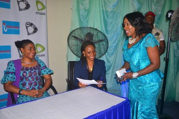 Cross River State First Lady-Dr Mrs Linda Ayade, Manager-CSR-Etisalat Nigeria-Oyetola Oduyemi and DG CRSPHDA- Dr Betta Edu after signing the MOU