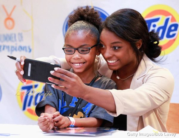 HOUSTON, TX - SEPTEMBER 30: Olympic gold medal-winning gymnast Simone Biles meets with fans in her home town at Kroger on September 30, 2016 in Houston, Texas. (Photo by Bob Levey/Getty Images)