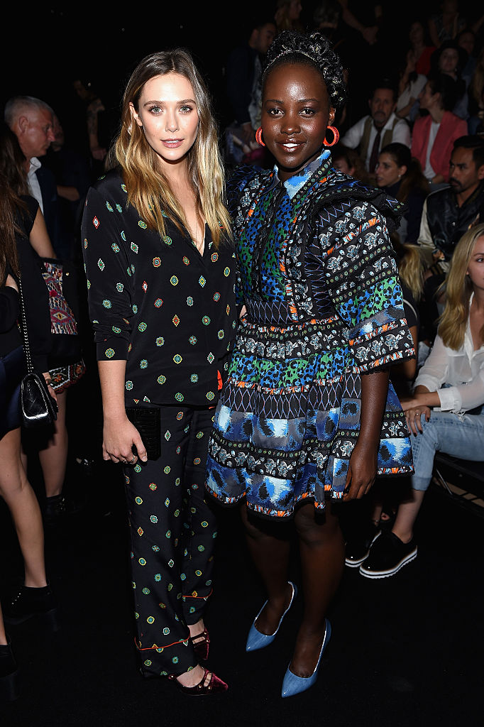 NEW YORK, NY - OCTOBER 19: Elizabeth Olsen and Lupita Nyong'o attend KENZO x H&M Launch Event Directed By Jean-Paul Goude' at Pier 36 on October 19, 2016 in New York City. (Photo by Dimitrios Kambouris/Getty Images for H&M)