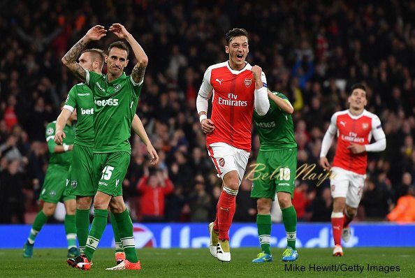 esut Ozil of Arsenal celebrates after scoring his third and his team's sixth goal of the game