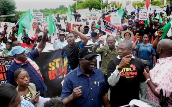 Pic.11. National president of the Nigeria Labour Congress (NLC), Commrade Ayuba Wabba leading a rally to protest and demand for tax justice in Africa, on Wednesday (12/10/16/) in Abuja. 7618/12/10/2016/Deborah Bada/BJO/NAN
