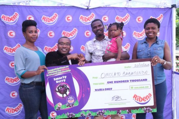 Account Executive Suntory Beverages and Foods Nigeria Limited, Mary Akindola, Brand Manager Ribena Essien Ekemini, Father of Beneficiary Kehinde Babatunde, Beneficiary Omolayo Babatunde and Customer Marketing Manager Suntory Beverages and Foods Nigeria Limited Grace Kanu at the Lagos Redemptions