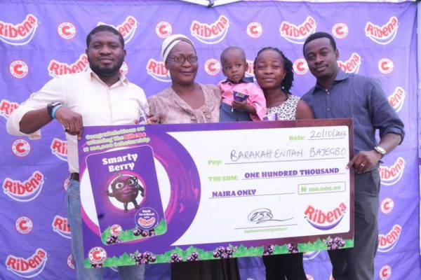 Group Product Manager Drinks Suntory Beverages Nigeria Limited and Foods Nigeria Limited Yusuf Murtala, Beneficiary's Mother Mrs Yetunde Bajegbo, Lagos Beneficiary Barakah Bajegbo, Representative Temidire Nursery and Primary School Ikorodu Lagos and Customer Marketing Manager Suntory Beverages and Foods Nigeria Limited Fiyinfuolu Adewakun