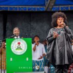 The Vice President, Professor Yemi Osinbajo and Omawumi recite the National Anthem