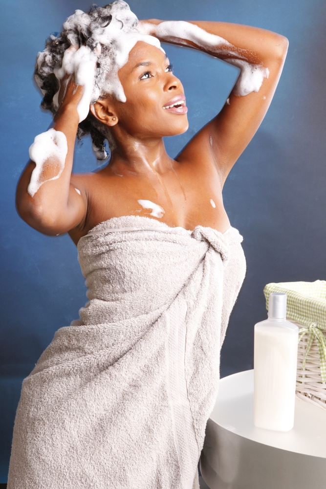 dreamstime black woman washing hair shampoo