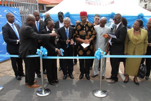 Okamaka Okoye, Managing Director, Juhel Nigeria Ltd. and customer, Union Bank cutting the ribbon to launch the Union Bank, Zik Avenue branch in Enugu