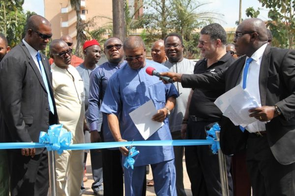 Engr. Ndubueze Enekwa cutting the ribbon to officially open the refurbished branch in Enugu
