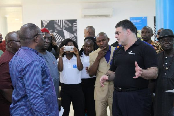 Carlos Wanderley, Head, Retail Banking, Union Bank, giving guests a tour of the new branch in Garden Avenue, Enugu