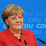 Angela Merkel, Germany's chancellor and Christian Democratic Union (CDU) party leader, smiles while speaking during a news conference at the party's headquarters in Berlin, Germany, on Sunday, Nov. 20, 2016. Merkel told senior members of her Christian Democratic Union that she'll run again as party leader and seek a fourth term as German chancellor, ending months of speculation over her political future. Photographer: Krisztian Bocsi/Bloomberg via Getty Images