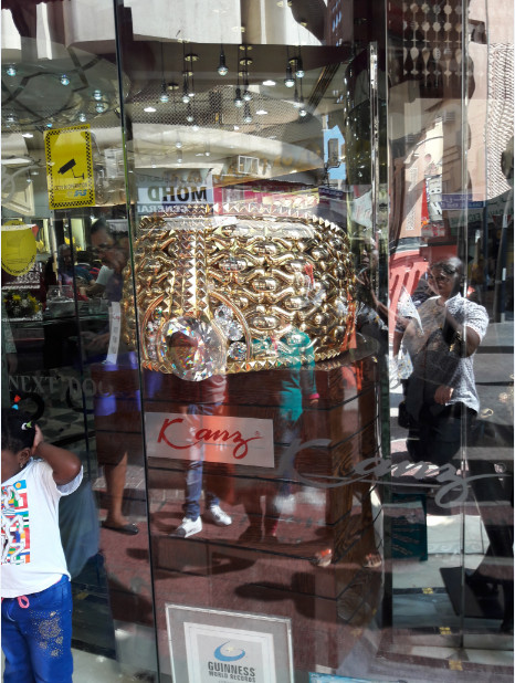 The World's heaviest Gold Ring - Najmat Taiba. Mounted on 5.17kg of precious stones and set on a 58.686kg 21 carat Gold ring, It was created by Taiba for Gold and Jewellery Co., Ltd.