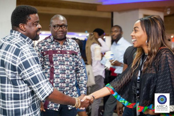 filmmaker-kunle-afolayan-welcoming-some-foregn-guests-at-the-ongoing-afriff-1