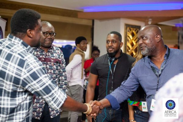 filmmaker-kunle-afolayan-welcoming-some-foregn-guests-at-the-ongoing-afriff-2