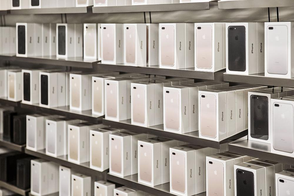 Boxes of Apple Inc. iPhone 7 Plus smartphones sit on shelves at the Apple Store inside the IAPM shopping mall in Shanghai, China, on Friday, Sept. 16, 2016. Apple hopes its new iPhone 7 will help to stem a two-quarter decline in iPhone sales by enticing users to upgrade to the 7's faster processor and expanded memory options. Photographer: Qilai Shen/Bloomberg via Getty Images