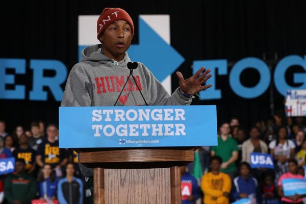 RALEIGH, NC - NOVEMBER 03:  Recording artist Pharrell Williams speaks during a campaign rally with Democratic presidential nominee Hillary Clinton at Coastal Credit Union Music Park at Walnut Creek on November 3, 2016 in Raleigh, North Carolina. With less than a week before election day, Hillary Clinton is campaigning in North Carolina.  (Photo by Justin Sullivan/Getty Images)