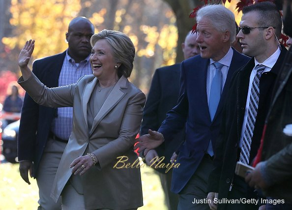 Democratic presidential nominee former Secretary of State Hillary Clinton (L) and her husband former U.S. President Bill Clinton greet supporters after voting at Douglas Grafflin Elementary School on November 8, 2016 in Chappaqua, New York. Hillary Clinton cast her ballot in the presidential election as the rest of America goes to the polls to decide between her and Republican presidential candidate Donald Trump.